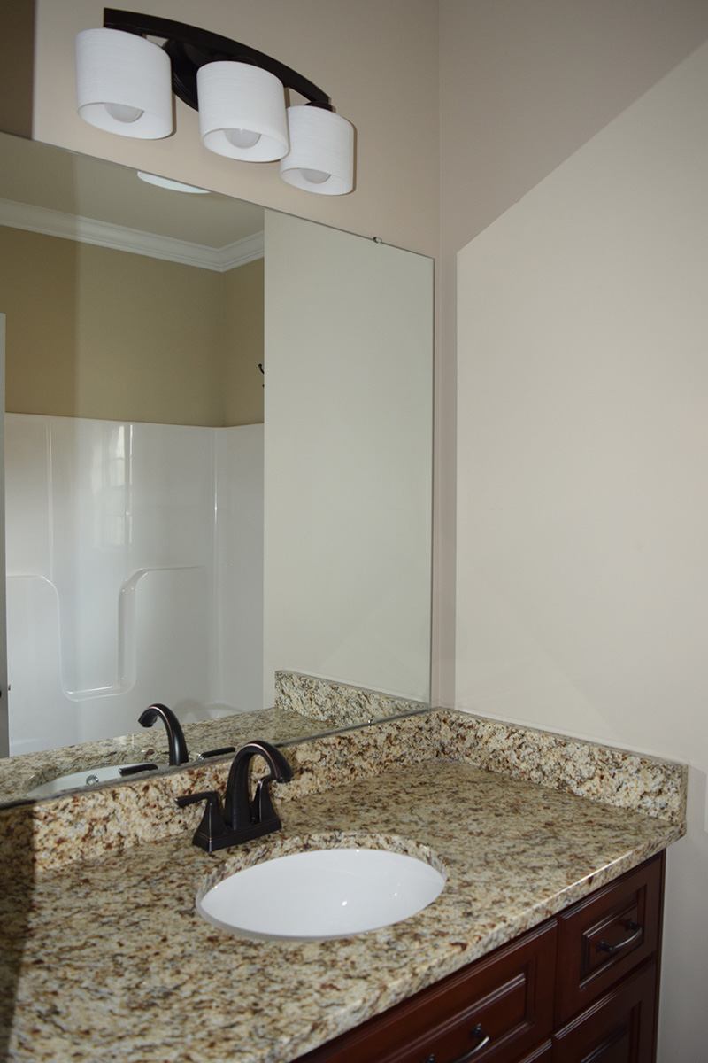 Hill Construction guest bathroom sink with granite countertops
