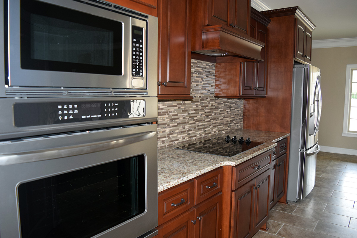 Hill Construction Kitchen with double oven, granite counter tops, and glass top stove.
