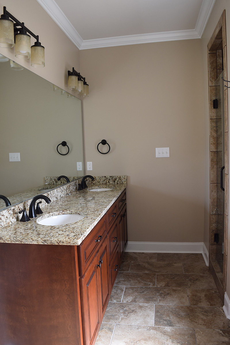 Hill Construction master bathroom with double sinks and granite countertops