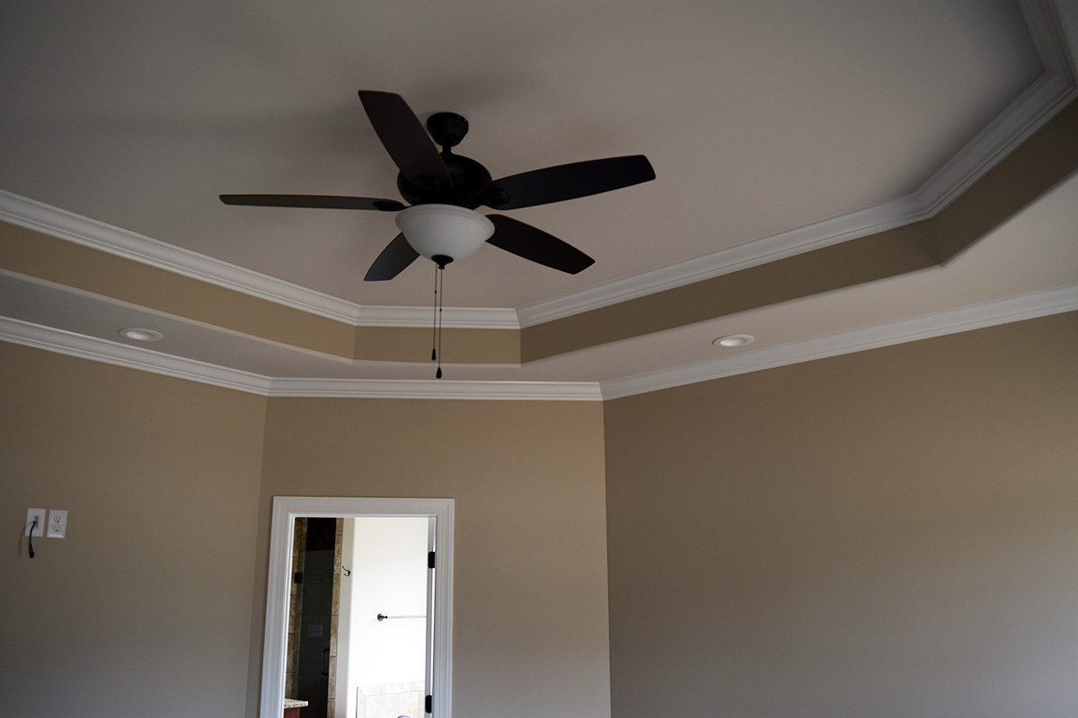 Hill Construction master bedroom with tray ceiling and fan