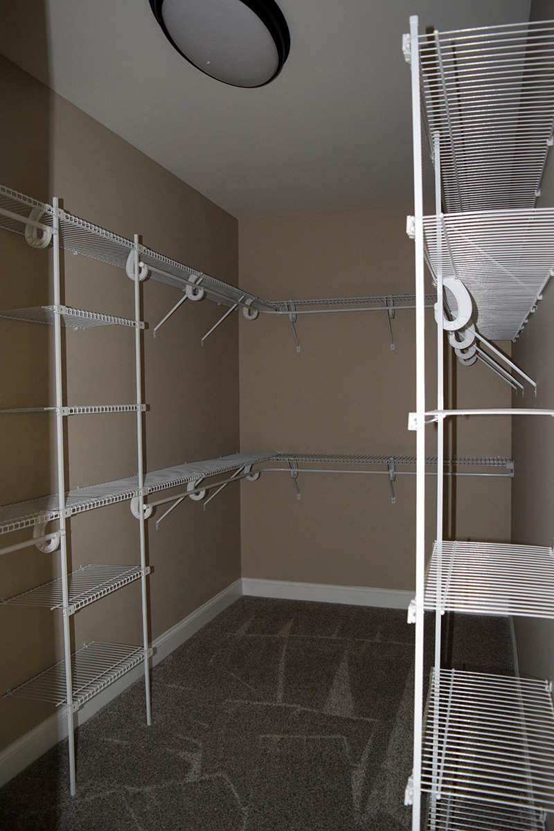 Hill Construction master bedroom walk in closet with wire shelving