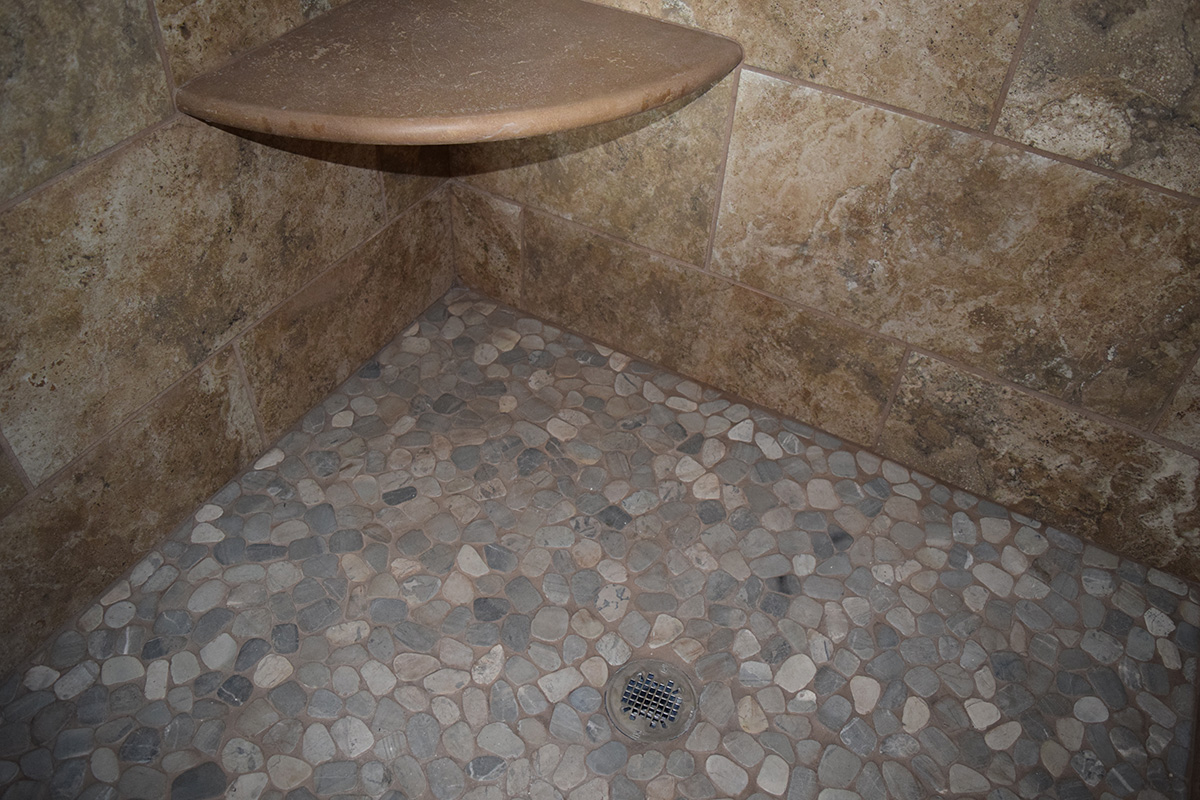 Hill Construction stone shower floor and shelf
