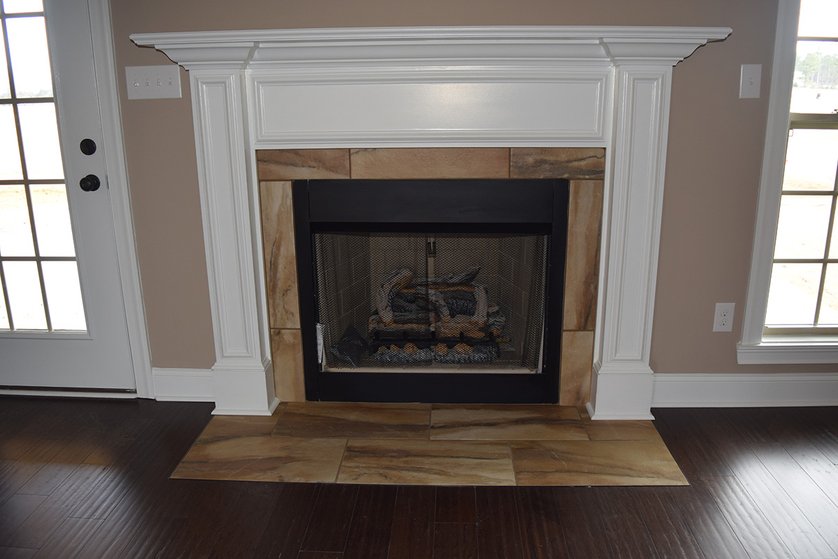 Hill Construction based in Decatur, AL brown marbled stone gas fireplace.