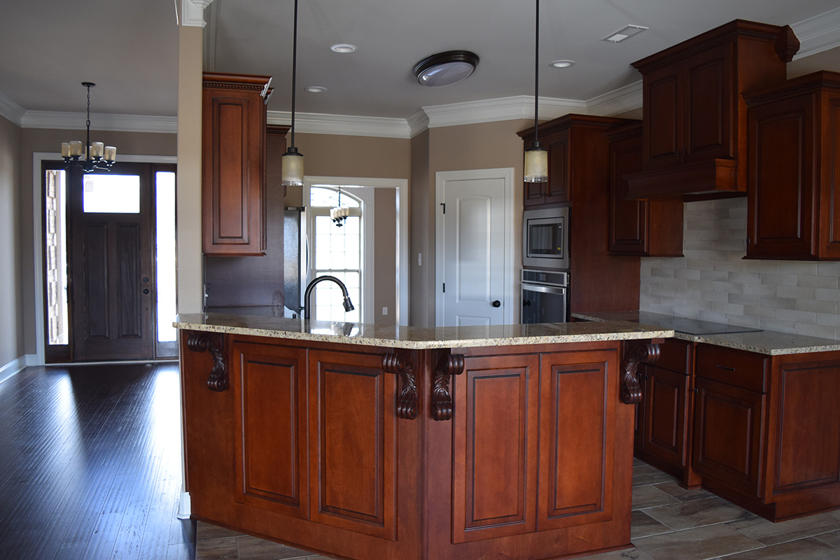 Hill Construction based in Decatur, AL open kitchen with wrap around bar.