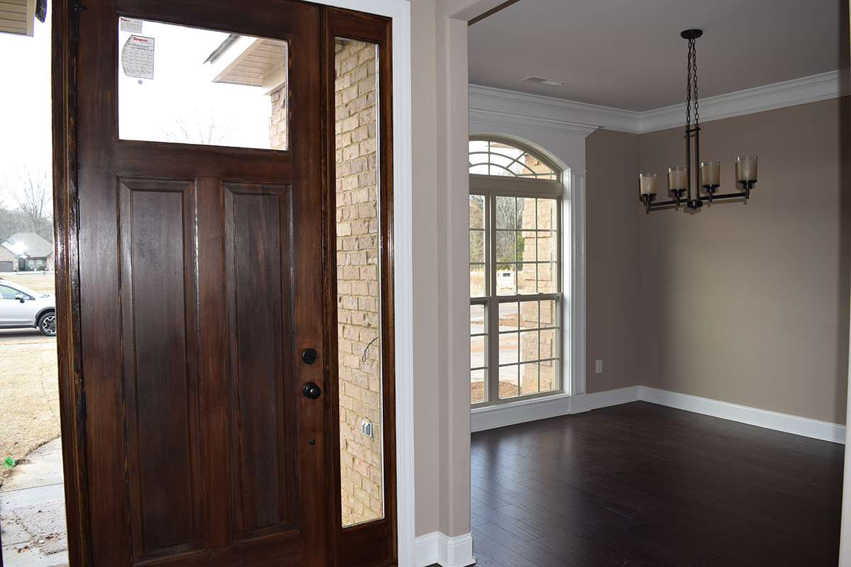 Hill Construction based in Decatur, AL wooden front door and dining room.
